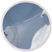 A Lone Skier Descends A Steep Line Round Beach Towel
