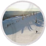 A Lone Skier Makes A Turn At Whitefish Round Beach Towel