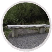 A Long Stone Section Over Wooden Stumps Forming A Rough Sitting Area Round Beach Towel