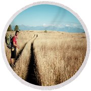 A Male Hiker In Montana Round Beach Towel