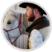 A Male Ranch Hand In A Cowboy Hat Round Beach Towel