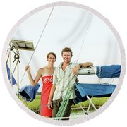 A Man And A Woman Embrace In Sailboat Round Beach Towel