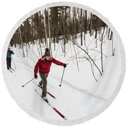 A Man And Woman Cross Country Skiing Round Beach Towel
