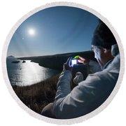 A Man Captures The Full Moon Round Beach Towel