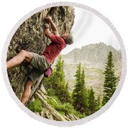 A Man Clinging To Rock Face In The Round Beach Towel