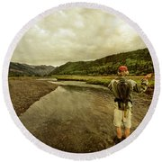 A Man Flyfishing On A River Round Beach Towel