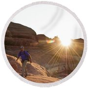 A Man Hiking In The Needles District Round Beach Towel