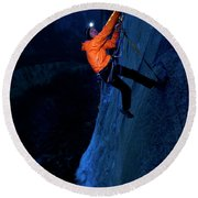 A Man Jumaring To A Route On El Cap Round Beach Towel