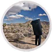 A Man Looks Into The Distance Round Beach Towel