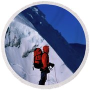 A Man Mountaineering In The Alps Round Beach Towel