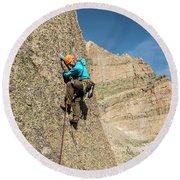 A Man Rock Climbing In Rocky Mountain Round Beach Towel