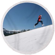 A Man Runs Alone On A Late Winter Day Round Beach Towel