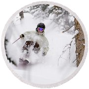 A Man Skiing Powder In The Trees Round Beach Towel