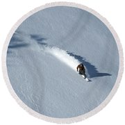 A Man Snowboards Down A Slope On Teton Round Beach Towel