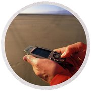 A Man Using A Gps Device At Sunset Round Beach Towel