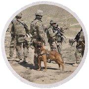 A Military Working Dog Accompanies U.s Round Beach Towel
