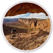A Mountain Biker Rides By On Slickrock Round Beach Towel