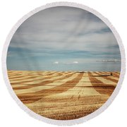 A Pattern Of Stripes Across A Farmers Round Beach Towel