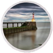 A Red And White Striped Lighthouse Round Beach Towel