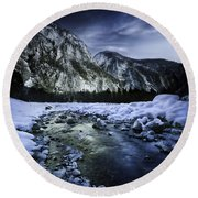 A River Flowing Through The Snowy Round Beach Towel