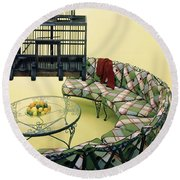 A Round Couch And A Birdcage Round Beach Towel