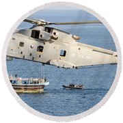 A Royal Navy Merlin Helicopter  Round Beach Towel