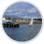 A Sailing Yacht Passes The Wharf In Sidney Harbour Round Beach Towel