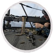 A Sailor Fires An M-240b Machine Gun Round Beach Towel by Stocktrek Images