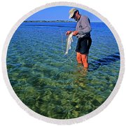 A Salt Water Fly Fisherman Catches Round Beach Towel