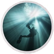 A Scuba Diver Ascends Into The Light Round Beach Towel by Michael Wood
