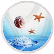 A Shell And Two Starfish Floating Round Beach Towel