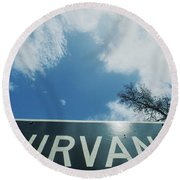 A Sign That Reads Nirvana Round Beach Towel