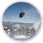 A Skier Doing A Front Flip Into Powder Round Beach Towel