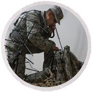 A Soldier Communicates Using A Round Beach Towel