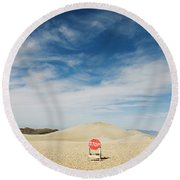 A Stop Sign In The Middle Of Nowhere Round Beach Towel