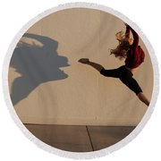 A Teenage Girl Playing With Her Shadow Round Beach Towel