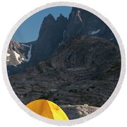 A Tent Is Dwarfed By The High Peaks Round Beach Towel