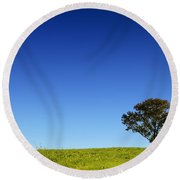 A Tree Stands Alone Round Beach Towel