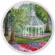 A Turn About The Garden Round Beach Towel