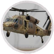A Uh-60l Yanshuf Helicopter Landing Round Beach Towel