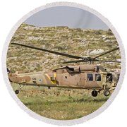 A Uh-60l Yanshuf Helicopter Round Beach Towel