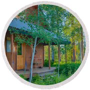 A View Of A Cottage With Aspen Trees Round Beach Towel
