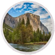 A View Of El Capitan From The Merced River Round Beach Towel