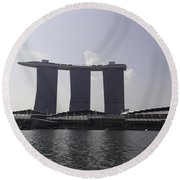 A View Of The Three Towers Of The Marina Bay Sands In Singapore Round Beach Towel