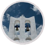 A Whitewashed Bell Tower And Dramatic Round Beach Towel