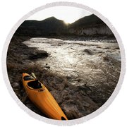 A Whitewater Kayak Rests On The Shore Round Beach Towel