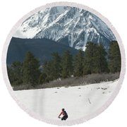A Woman Bike Riding On The  Snow Round Beach Towel