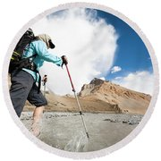 A Woman Is Crossing A River, Spiti Round Beach Towel