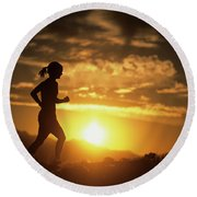 A Woman Jogs Under Sunset Round Beach Towel