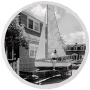 A Woman On Sailboat At Home Round Beach Towel